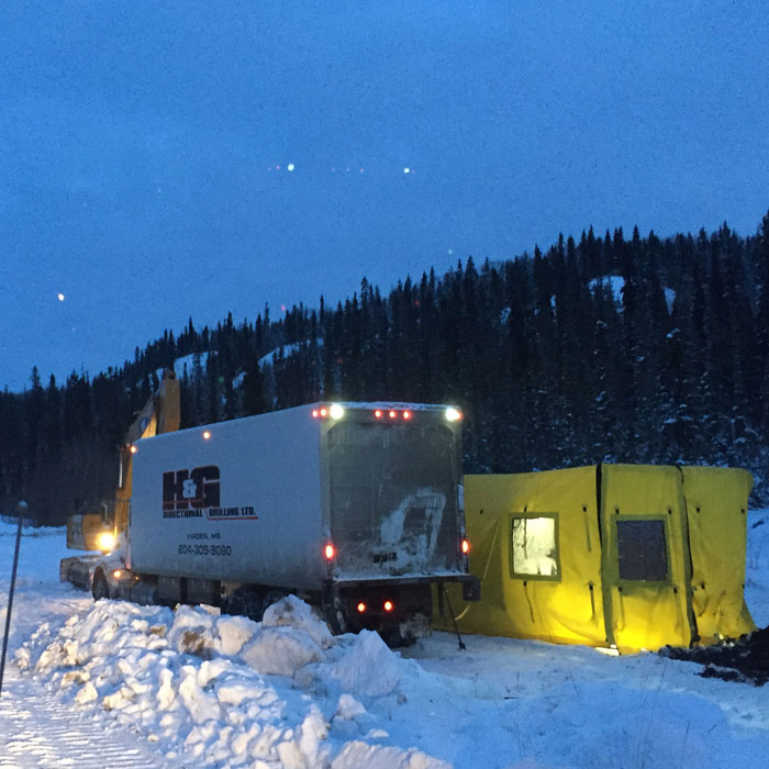 commercial truck and tent shelter in winter